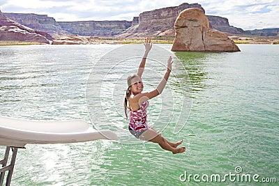 Woman Playing at the Lake