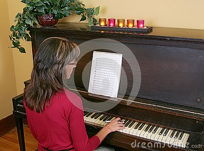 Woman playing music and composing