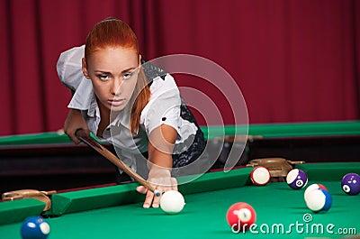 Woman playing pool.