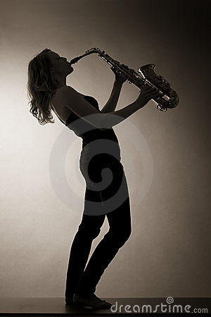 Woman playing saxophone, sepia toned.