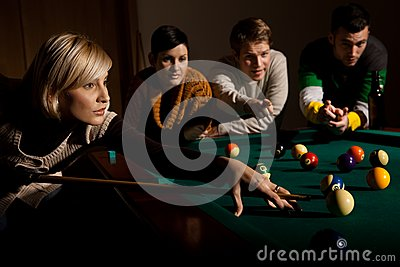 Woman playing snooker