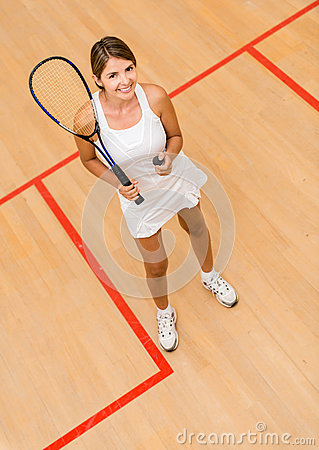 Woman playing squash