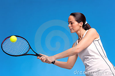 Woman playing tennis forearm shot