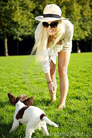 Woman Playing Wiith Dog In Park