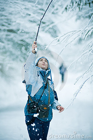 Woman playing in winter snow