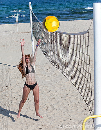 Woman plays in beach volleyball