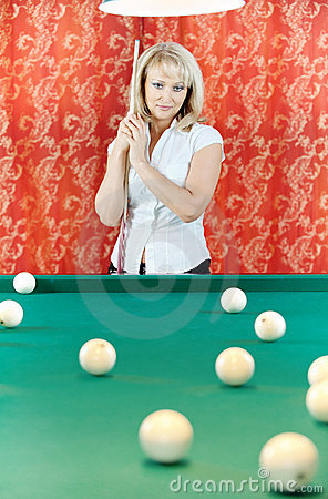 Woman plays billiards