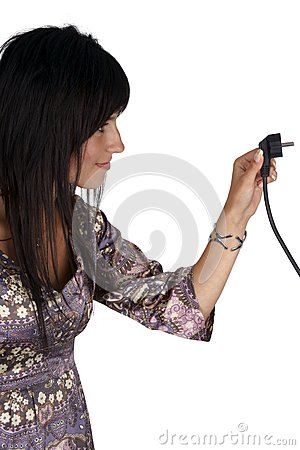 Woman plugging electric cord. Side view.