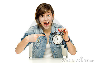 Woman pointing at alarm clock