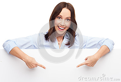 Woman pointing at blank poster