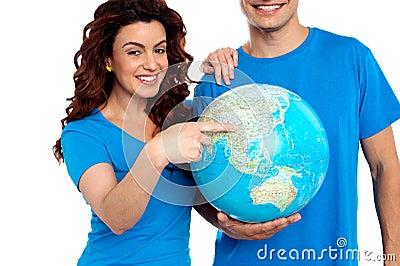 Woman pointing at China on globe