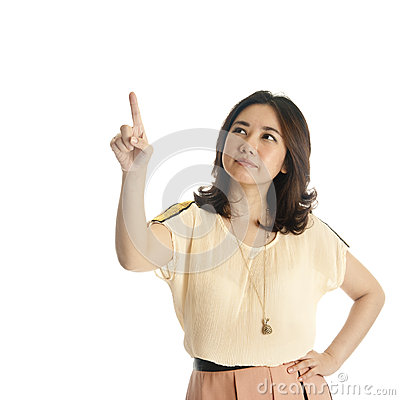 Woman pointing at copy space