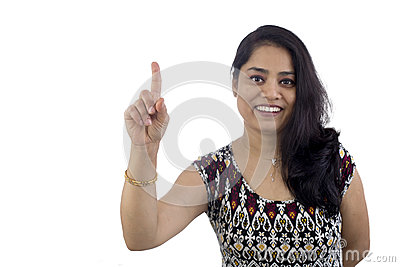 Woman pointing finger up showing ONE or WAIT A MINUTE.
