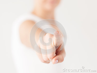 Woman pointing her finger at you