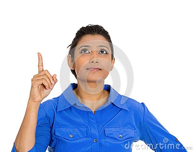 Woman pointing with index finger and looking upwards