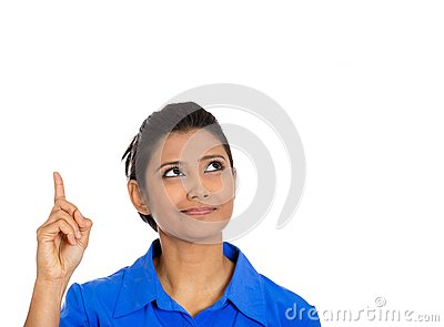 Woman pointing with index finger up and looking away or having the right answer