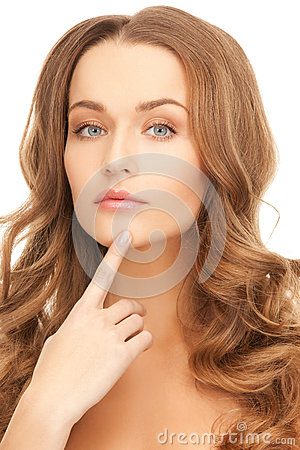 Woman pointing to chin