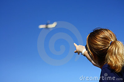 woman pointing towards the blue sky