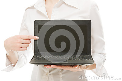 The woman points his finger on a laptop.
