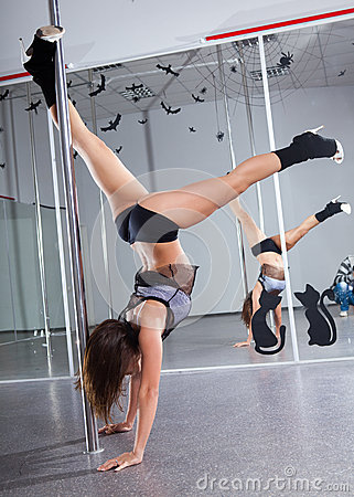 Woman and pole-dance
