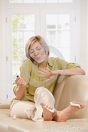Woman polishing nails