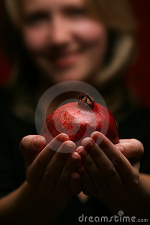 Woman and pomegranate