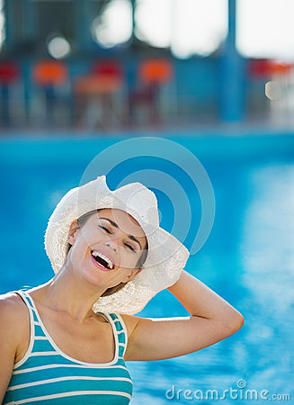 Woman at pool bar enjoying vacation