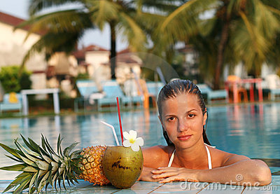 Woman in pool with fruits