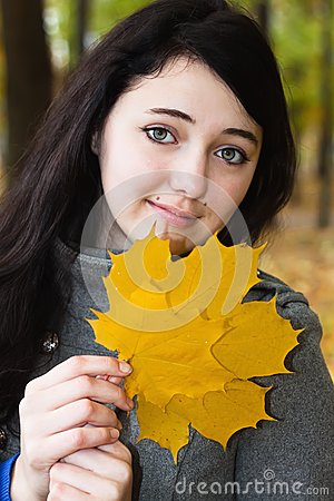 Woman portrait with autumn leaf
