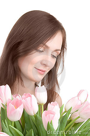 Woman portrait with bouquet of tulips