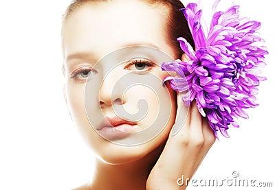 Woman portrait with chrysanthemum. Spa treatment.