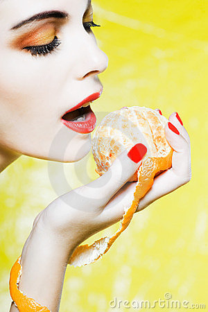Woman Portrait eating a mandarin orange tangerine