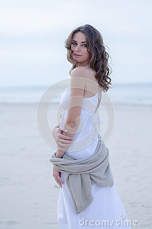 Free Woman Portrait On The Beach. Happy Beautiful Curly-haired Girl Full-length, The Wind Fluttering Hair. Spring Portrait On The Beach Royalty Free Stock Photos - 94268828