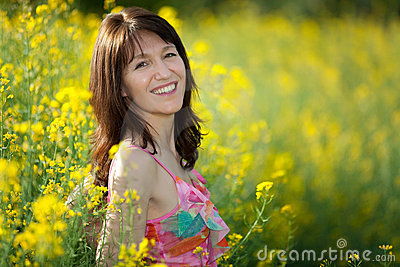 Woman portrait in rape field