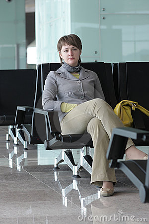Woman poses in airport