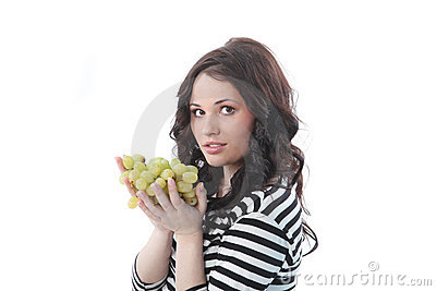 Woman poses with grapes in hands