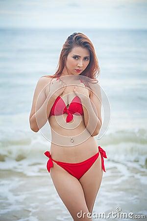 Woman posing at beach