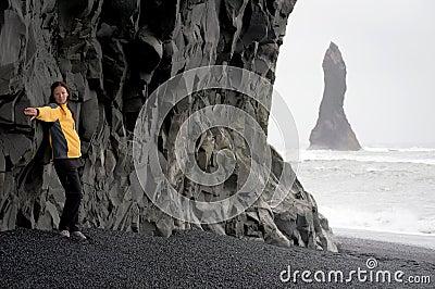 Woman posing on the Black sand beach, Iceland