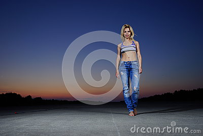 Woman posing on concrete road