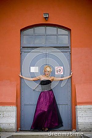 Woman posing in doorway