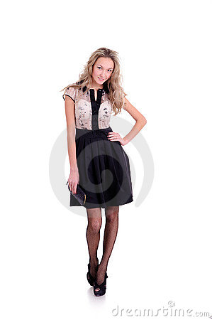 Woman posing in dress with skirt