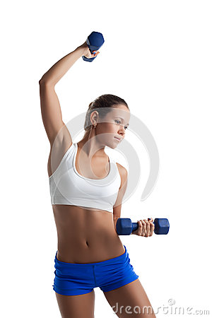 Woman posing with dumbbells in fitness costume