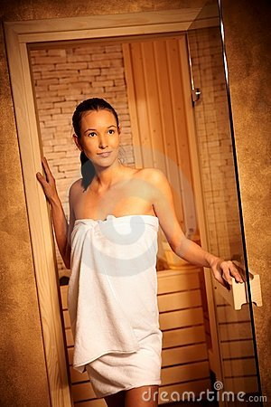 Woman posing at entrance of sauna