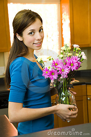 Woman posing with flowers