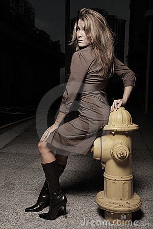 Woman posing by a frie hydrant
