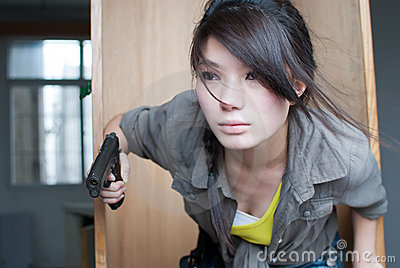 Woman posing with guns