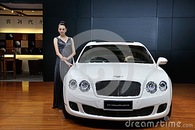 Woman posing near car at Chengdu Motor Show 2012 Editorial Photography