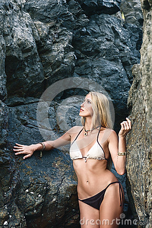 Woman posing near cliffs