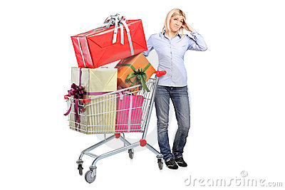 A woman posing next to a shopping cart