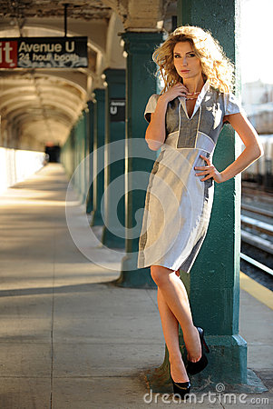 Woman posing outside in NYC subway